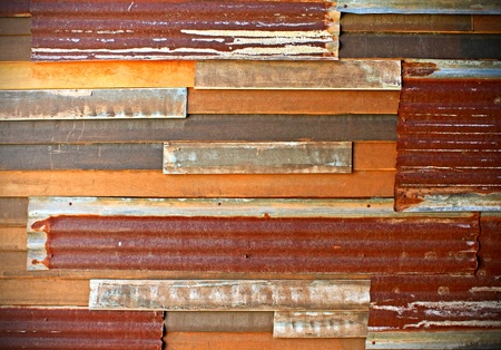 damaged roof: background image of rusty corrugated iron sheets