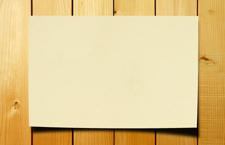 blank paper on wood table photo