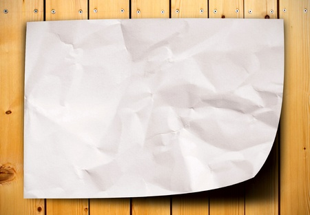 blank crumpled paper on wood table photo