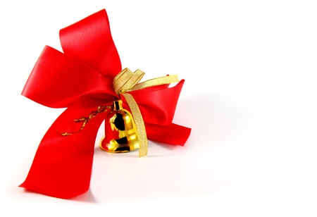 ribbon golden bell with red satin bow isolated on white Stock Photo - 9983072