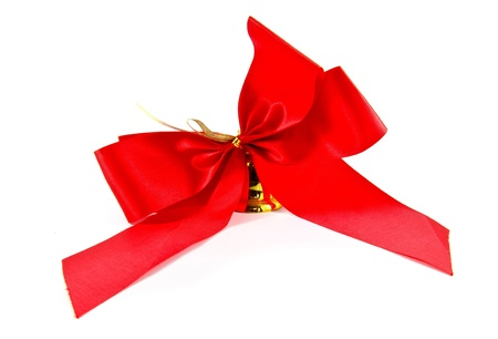 ribbon golden bell with red satin bow isolated on white Stock Photo - 9983068