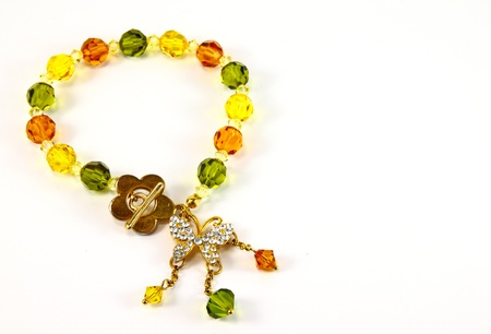 bracelet with color gems on a white background photo