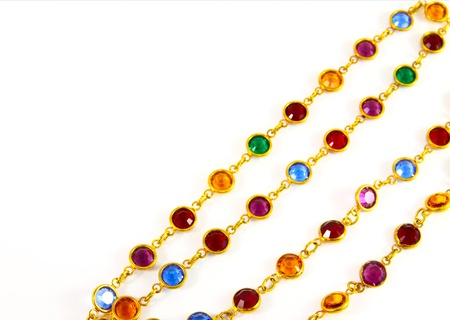 colorful necklace crystal on white background photo