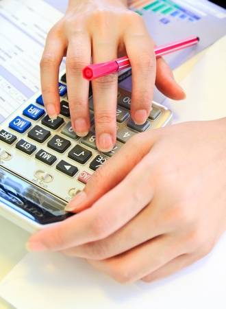 woman hands with calculator photo
