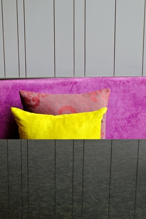 decorative pillows on a contemporary sofa with table photo