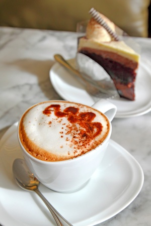 hot cappuccino with cake photo