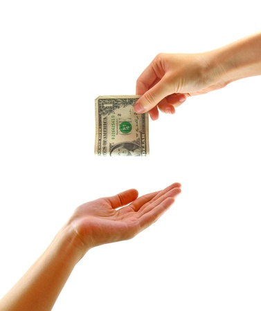 Hand giving money to other hand isolated photo