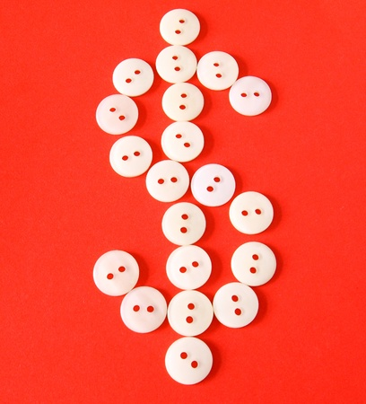 Figure $ from buttons on a red background  photo