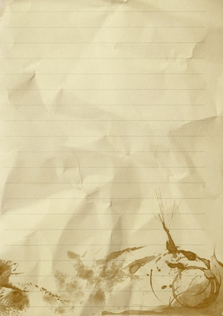 empty sheet of line crumpled paper with coffee stained  photo