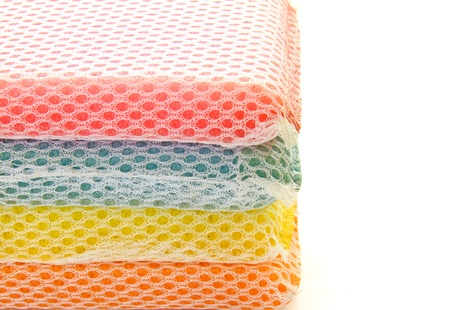 Stack of colorful sponges isolated photo