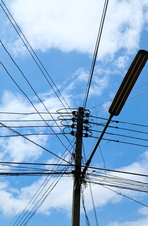 high voltage: electric light with blue sky