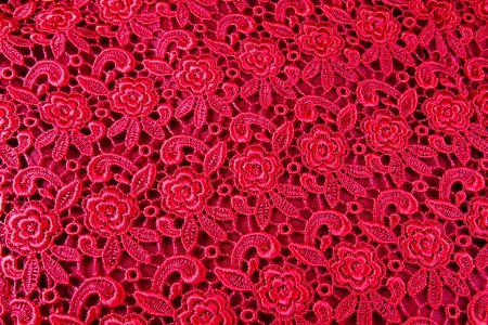 Detail of red lace pattern fabric photo
