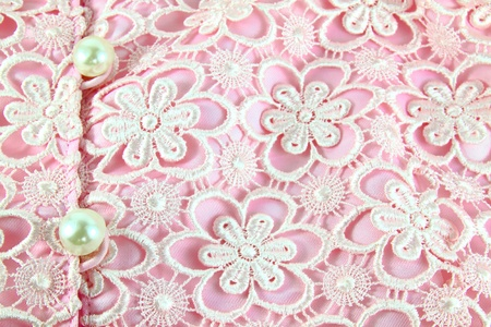 Detail of pink lace pattern fabric with pearl photo