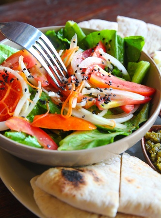 mediterrenean salad with cheese and bread photo