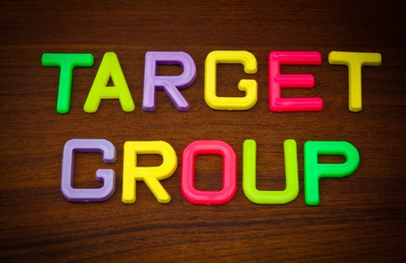 Target group in colorful toy letters on wood background Stock Photo - 10563611