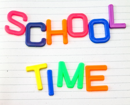 school time: School time in colorful toy letters on lined paper background