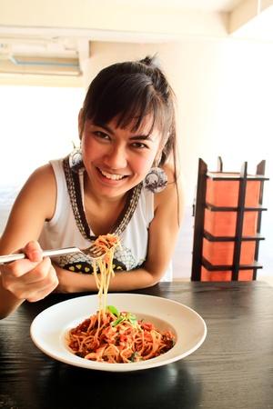 Beautiful asian woman eating spaghetti in restaurant  photo