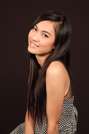 Beautiful asian woman with black background