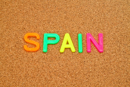 Spain in colorful toy letters on cork background Stock Photo - 10766817