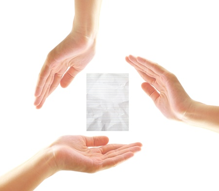 co operation: Female hands with crumpled paper in recycle concept