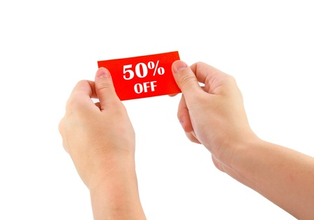 hands holding red card with 50 percent off isolated on white  photo