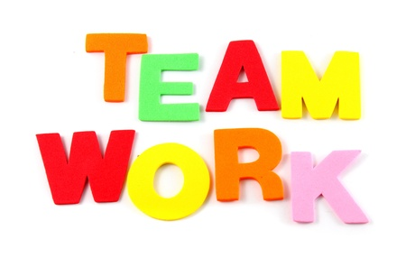 Team work in colorful toy letters on white background  photo