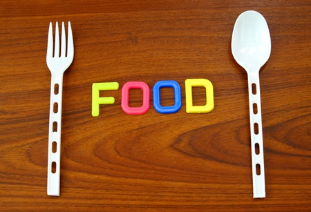 food in colorful letters with plastic spoon and fork photo