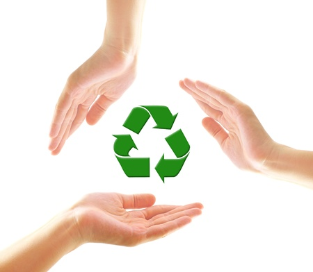Female hands with recycle icon  photo