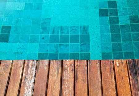 pool deck: old wood pavement with pool edge background