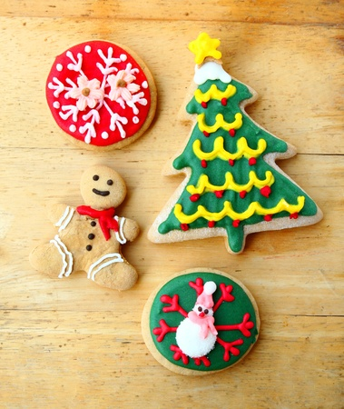 Decorated christmas gingerbreads on wooden background photo