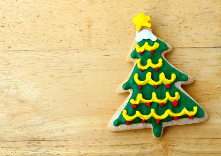Decorated christmas gingerbread on wooden background photo