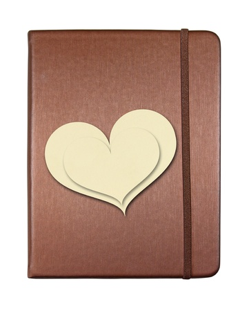 notebook cover: Brown cover notebook with heart shape paper isolated on white background