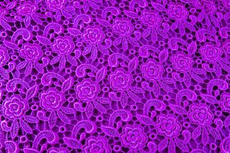 Detail of purple lace pattern fabric photo