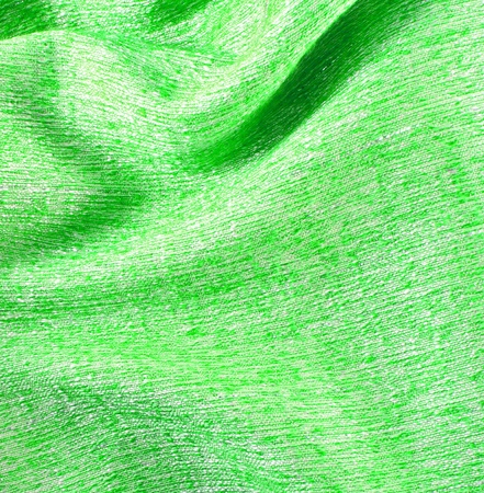 Green crumpled silk fabric textured background  photo