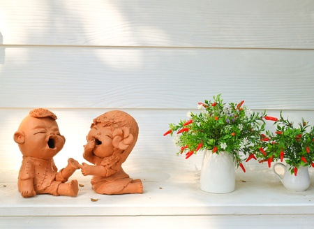 Doll clay and flower in ornamental garden photo