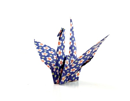 crane origami: Crane origami bird folded with a floral pattern paper  Stock Photo