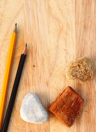 creative writing: Pencils on decorated wood background with copy space