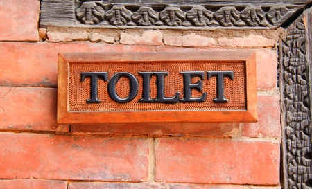 Ancient toilet sign on brick wall Stock Photo - 13077011