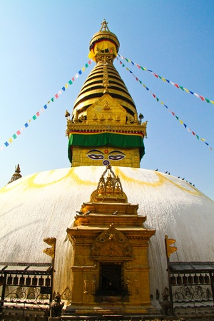 Stupa of the swayambhunath temple with blue sky in kathmandu, Nepal photo