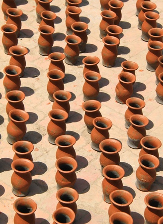 Many clay vases kept for drying photo