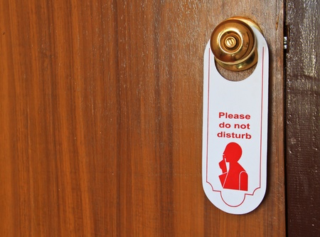Please do not disturb hotel tag hanging on door knob photo