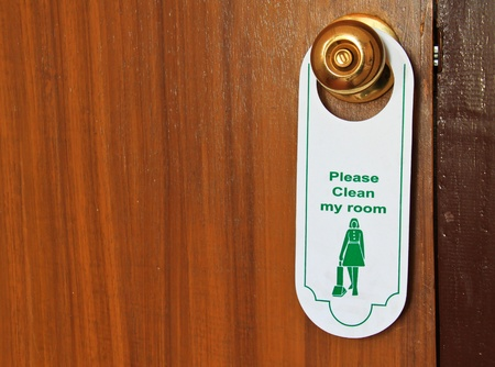 please clean my room hotel tag hanging on door knob Stock Photo - 13178286