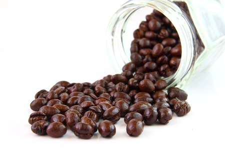 Coffee beans in a glass jar on white background photo
