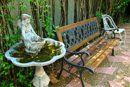 garden fountain: Bench and old fountain in garden