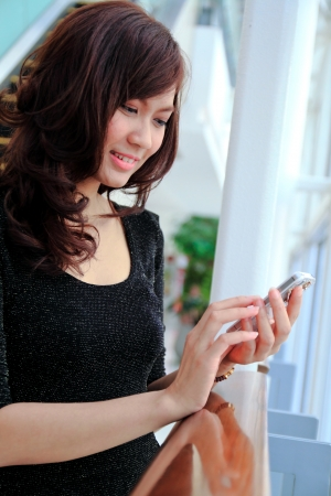 Asian Business woman using a Cell Phone photo