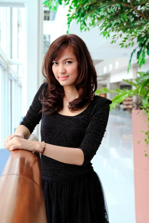 Beautiful asian woman smiling in modern building photo