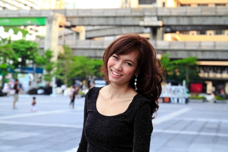 bangkok city: Young pretty asian woman smiling Stock Photo