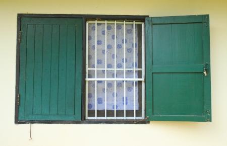 door casing: Green old wooden window