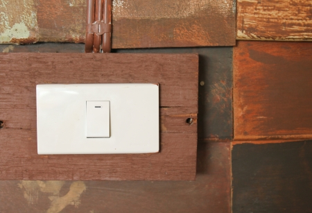 Switch button on grunge wooden wall photo