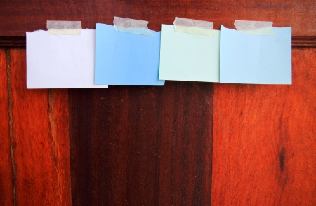 Notepaper attach with tape on wooden wall